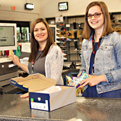 Employees standing at cash register